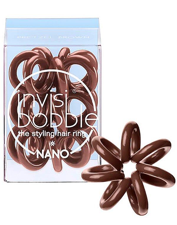Резинка для волос Invisibobble NANOСредства для укладки волос<br>Резинки invisibobble® NANO надежно фиксируют даже небольшие пряди. Использование аксессуаров позволяет бережно закрепить волосы в нужном положении, без применения заколок.<br><br>Цвет: Прозрачный - Crystal Clear,Коричневый - Pretzel Brown,Бежевый - To Be or Nude to Be,Чёрный - True Black